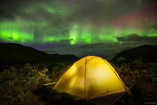 Canada, Divide Lake, Tombstone Territorial Park, Yukon, aurora, tent, northern lights, Tombstone Range