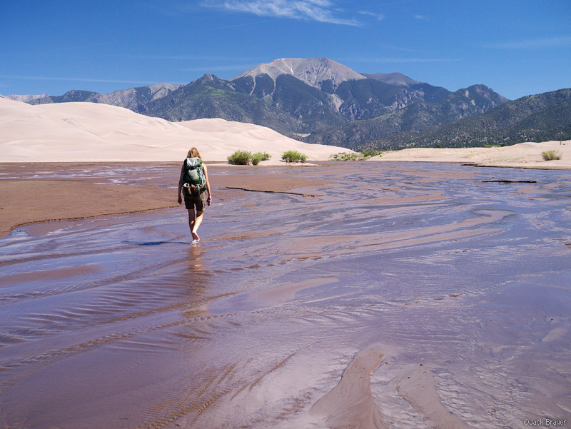 After scorching and sanding our bare feet on the hike out of the dunes, the walk up the cool waters of Medano Creek was pure...