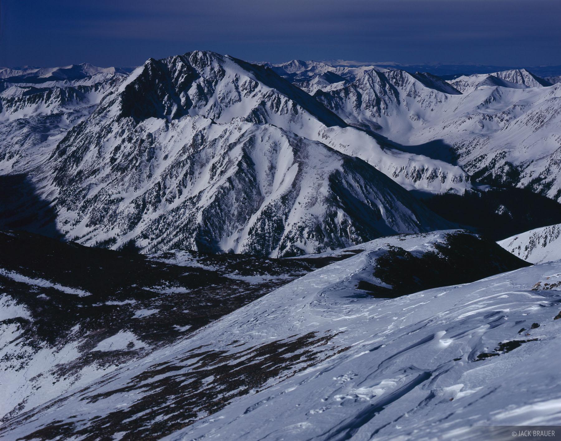 La Plata Peak illuminated by moonlight, as seen from the summit of Mt. Elbert, February 2008. La Plata Peak is Colorado...