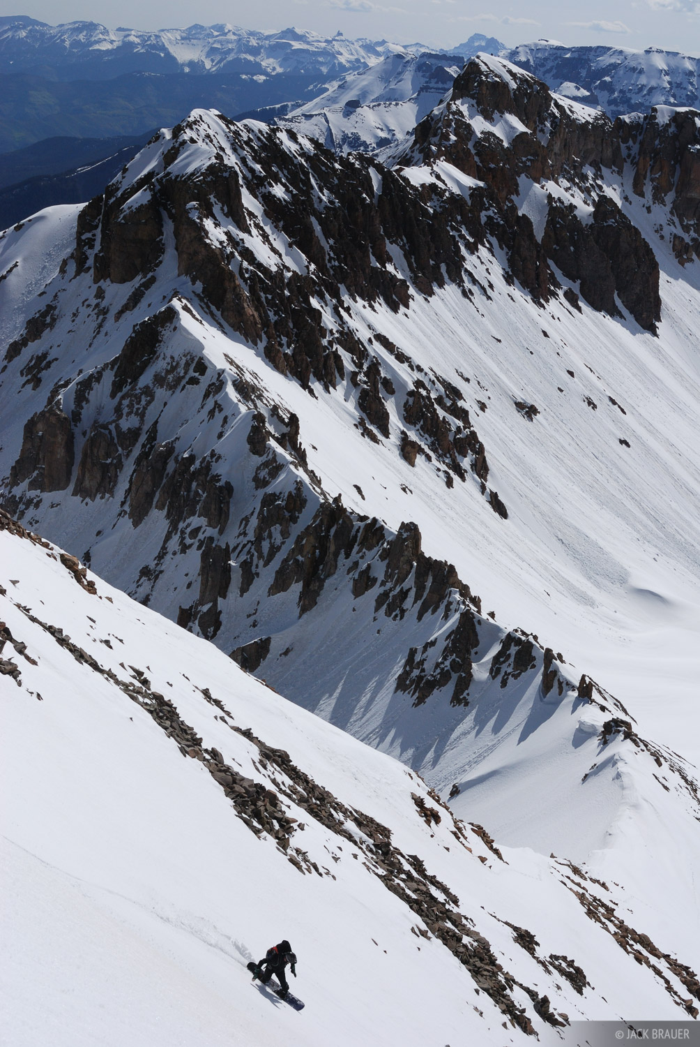 "Snowboarding down ""S5"", 13,380 feet, in the Sneffels Range - May.  Rider: Parker McAbery."
