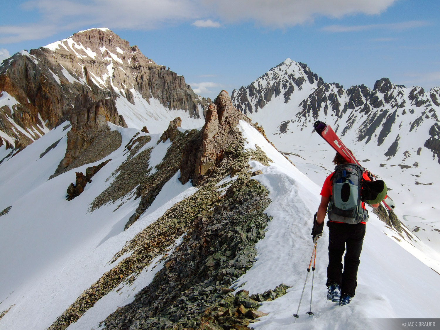 Hiking a ridgeline high above Yankee Boy Basin, about to ski down - June.  Gilpin Peak on the left, and Mt. Sneffels in the distance...