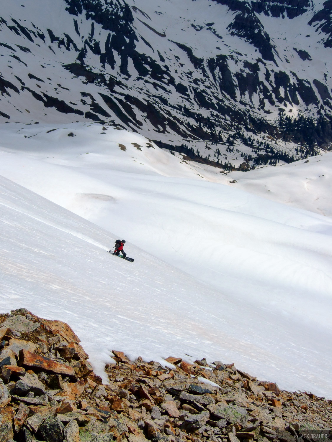Snowboarding down into Yankee Boy Basin - June.  Rider: Jack Brauer.  Photo by Jason Greer.