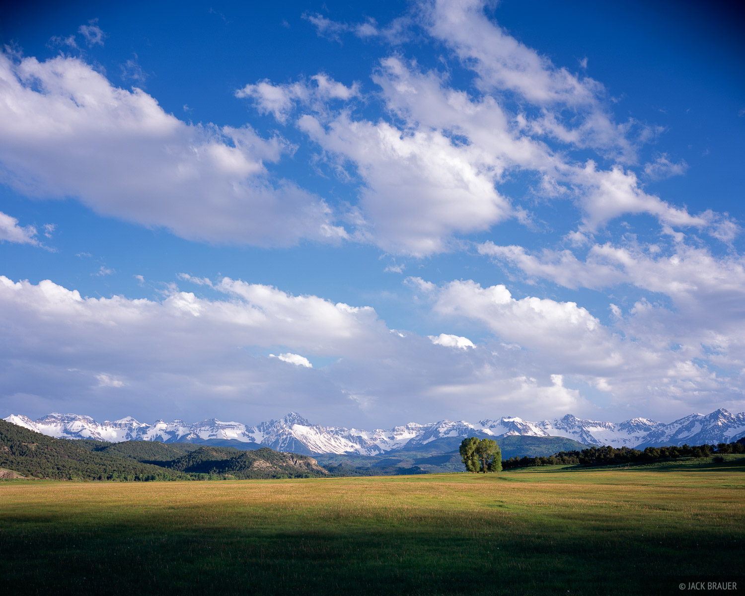 Big clouds, late afternoon light, and the Sneffels Range - May