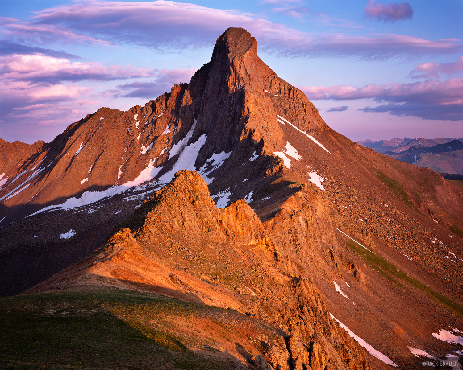 The rugged Wetterhorn Peak, 14,015 feet tall, soaks in the last sunlight of the day.  Uncompahgre Wilderness, July.