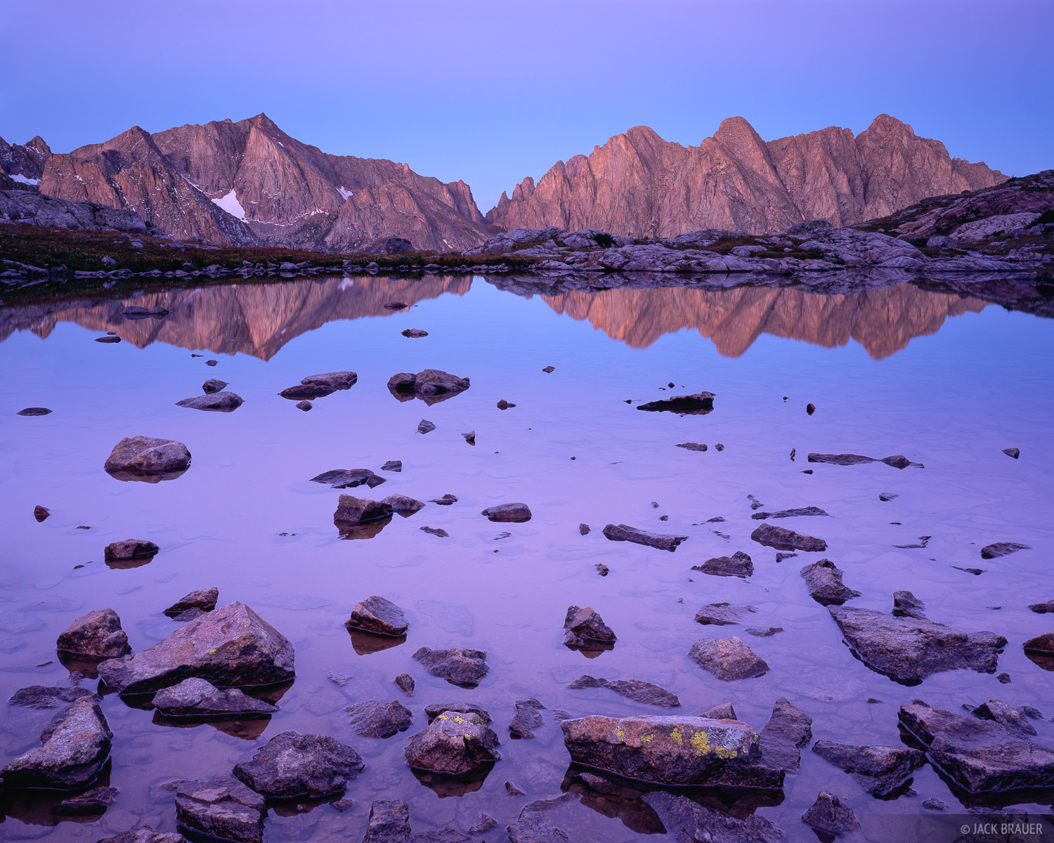 Dawn reflection of Mount Eolus in a high lake in the Needle Mountains, San Juan Mountains - September