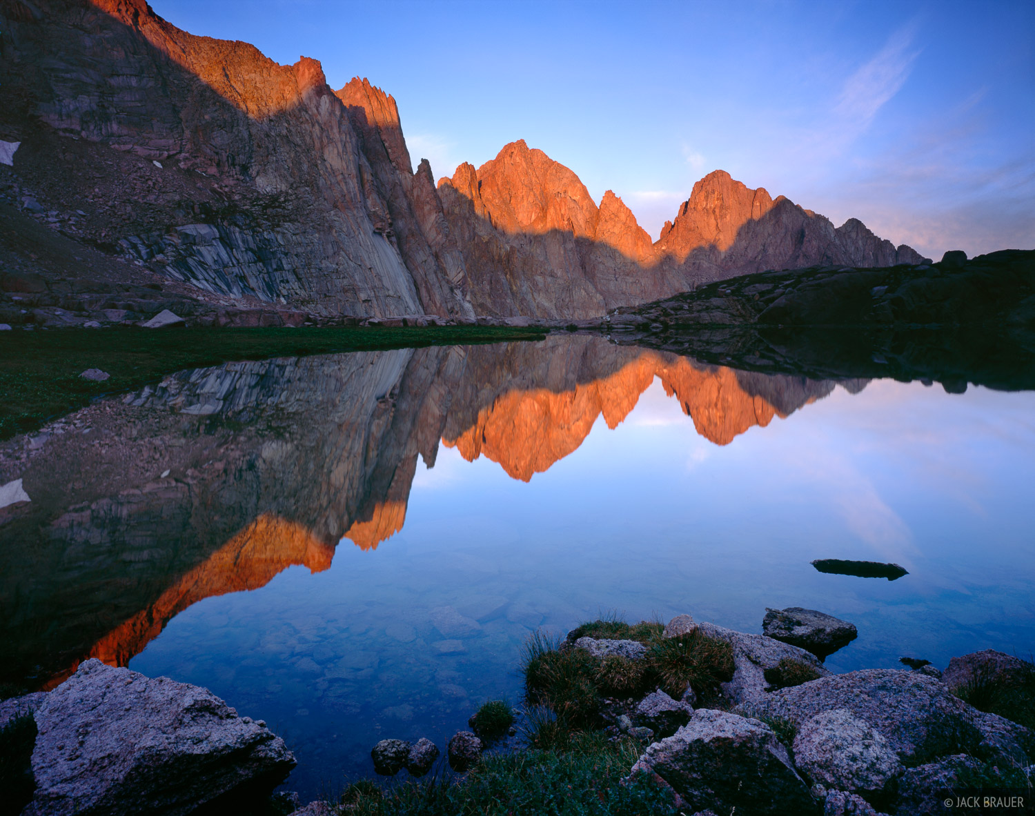 Morning alpenglow reflection of the Needle Mountains, San Juan Mountains - August
