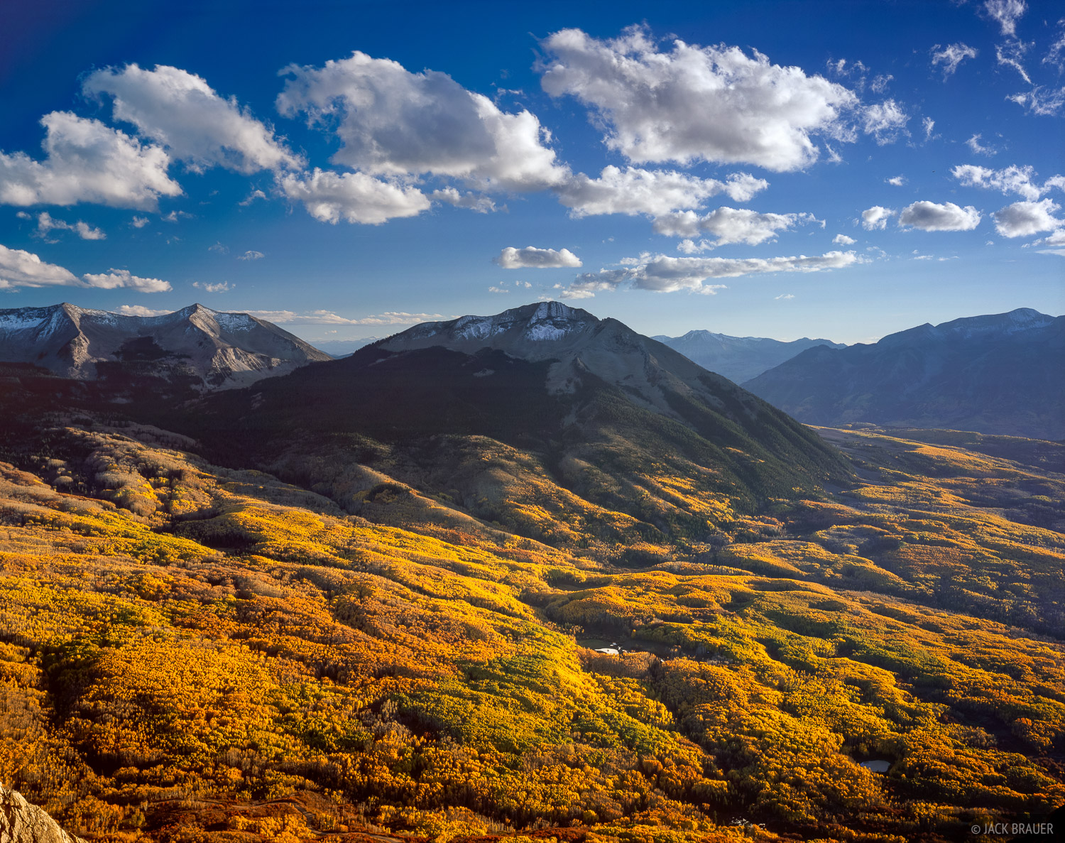 Autumn vista of the golden aspens on the slopes of West Beckwith Mountain, as seen from the summit ridge of Marcellina Mountain...