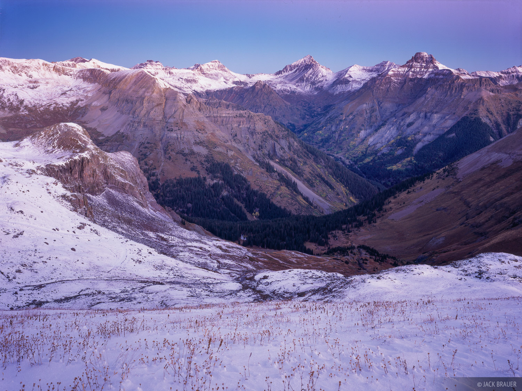 Dawn light illuminates Mt. Sneffles, Potosi Peak, and their lofty neighbors in the Sneffels Range, as seen from high on Richmond...