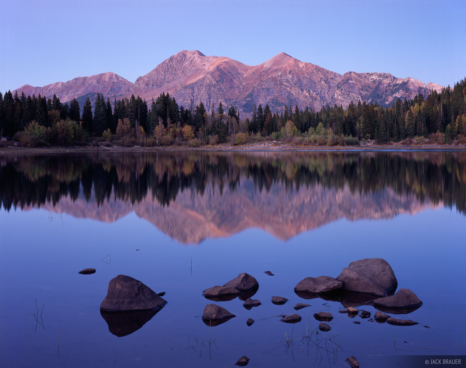 Mt. Owen, 13,058 ft., and Ruby Peak, 12,644 ft., reflected in Lost Lake Slough near Kebler Pass - September.