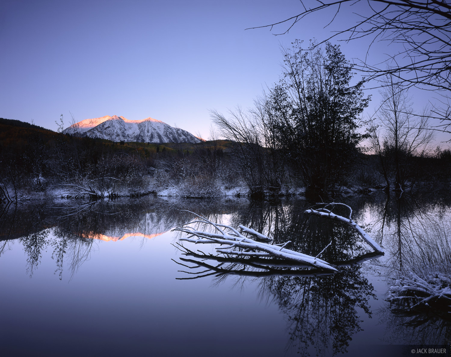 Sunrise light on East Beckwith Mountain, as seen from a beaver pond near Kebler Pass on a snowy September morning.