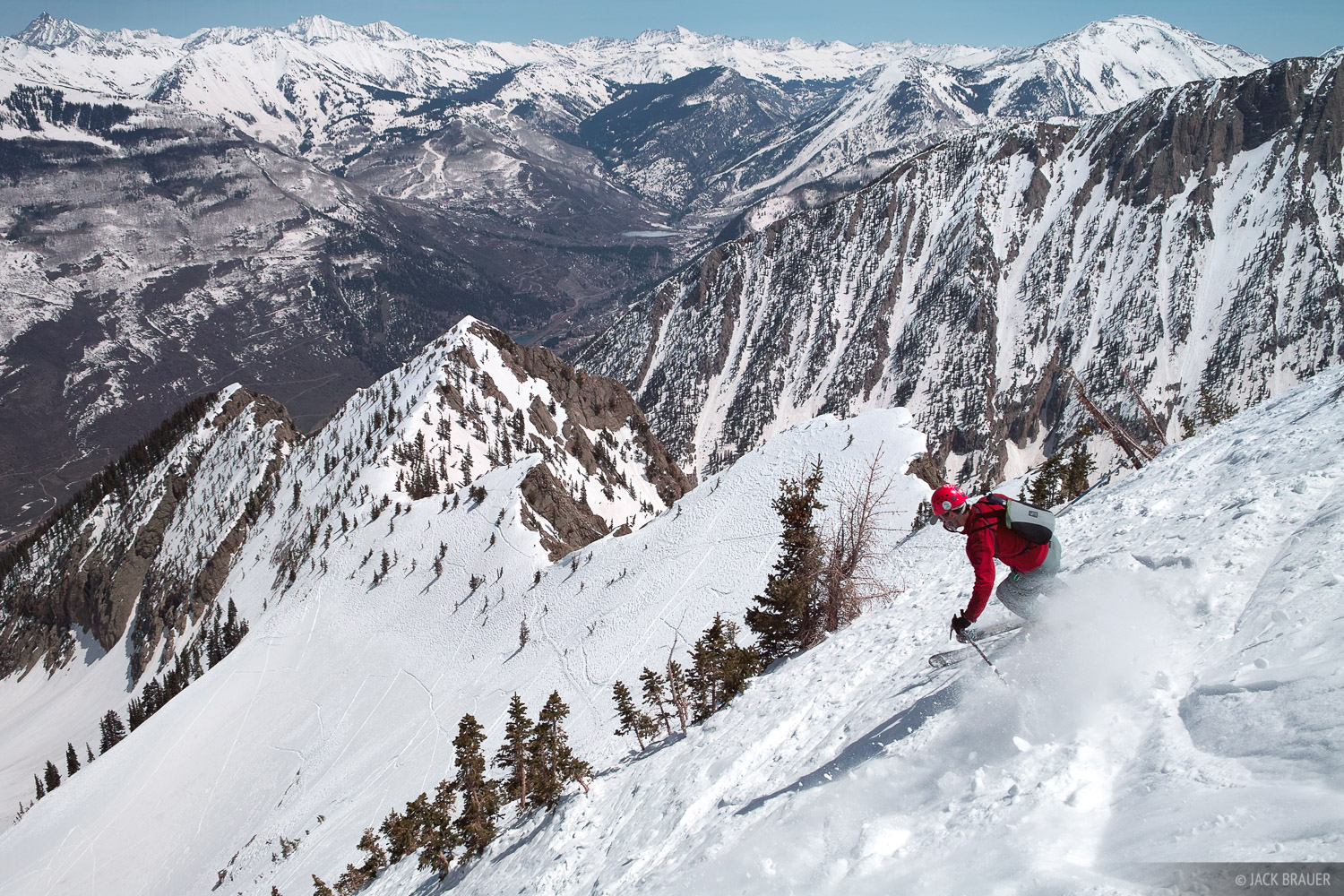 Seth Anderson skis from the summit, at the start of a great 4,000+ foot ski descent in the Ragged Mountains of Colorado - April...