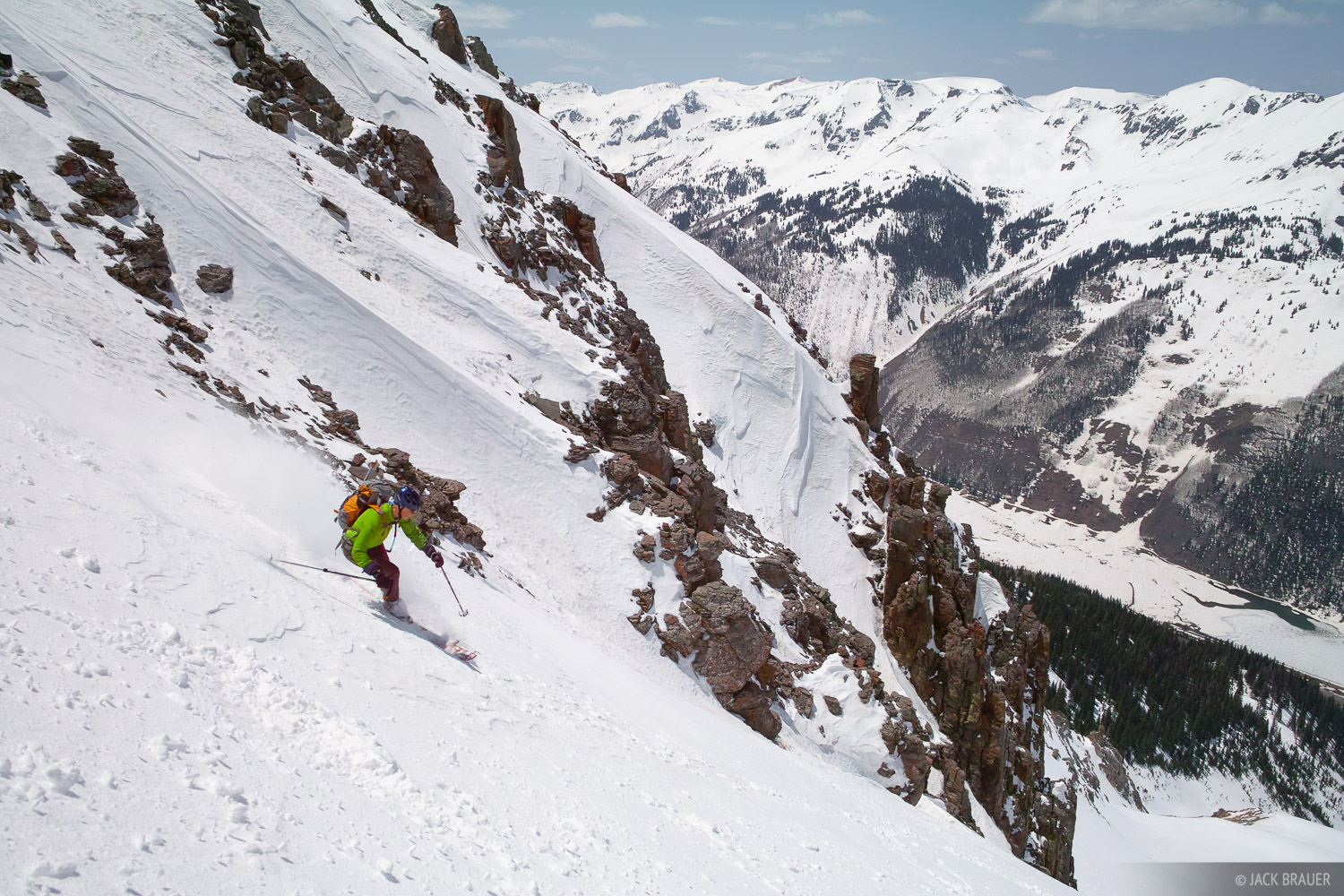 Skiing down Abrams Mountain, the big peak that towers above the town of Ouray as seen from the north.  Skier: Ann Driggers....