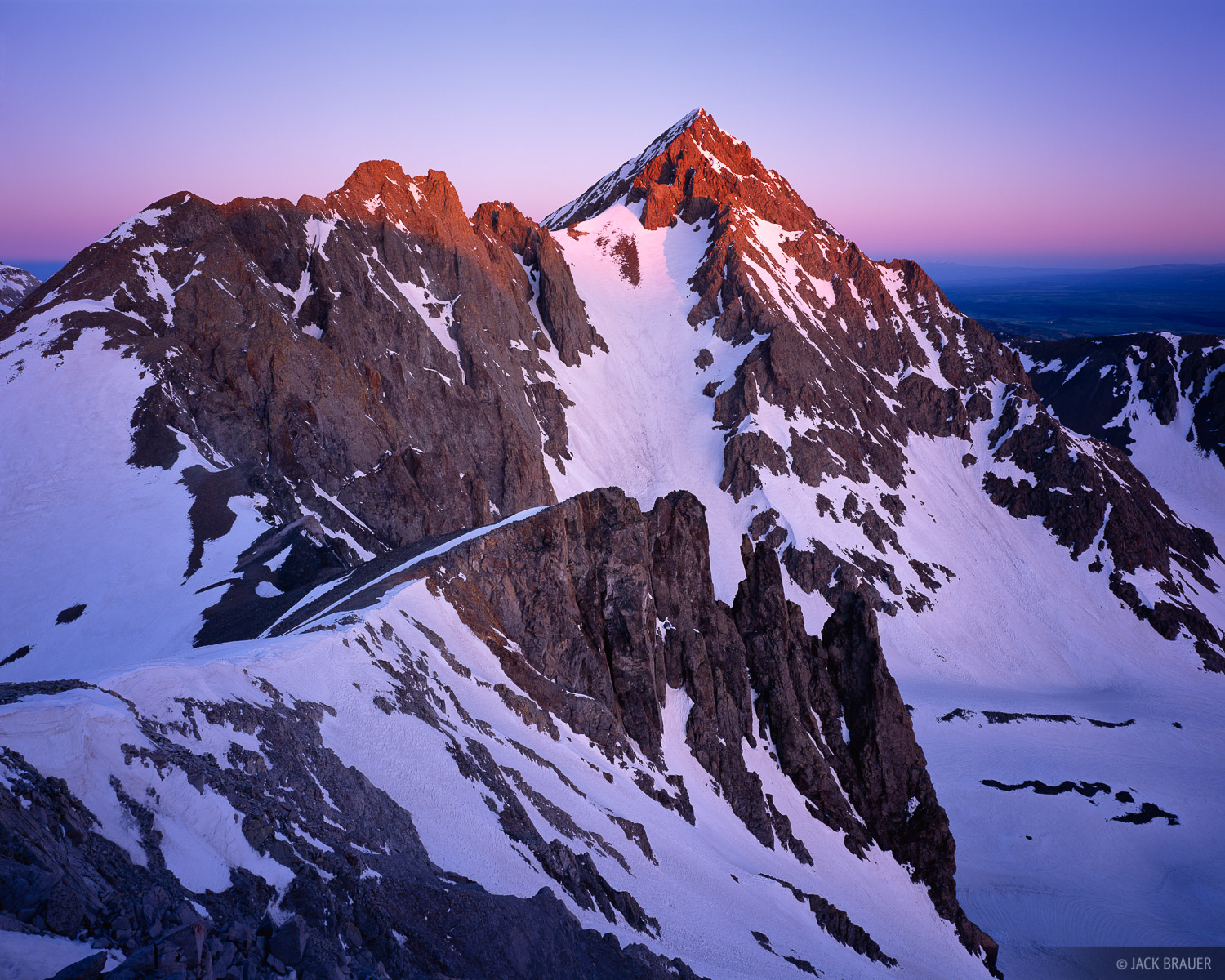 Sunrise alpenglow light shines on the summit of Mt. Sneffels, 14,156', as seen from the east - June.