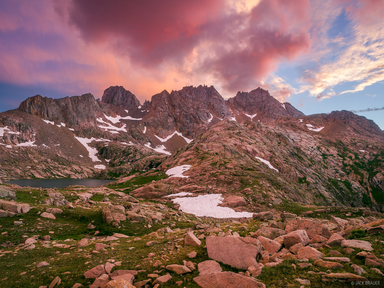 A colorful cotton candy Colorado sunset above Windom and Sunlight Peaks, two 14ers deep in the Weminuche Wilderness.