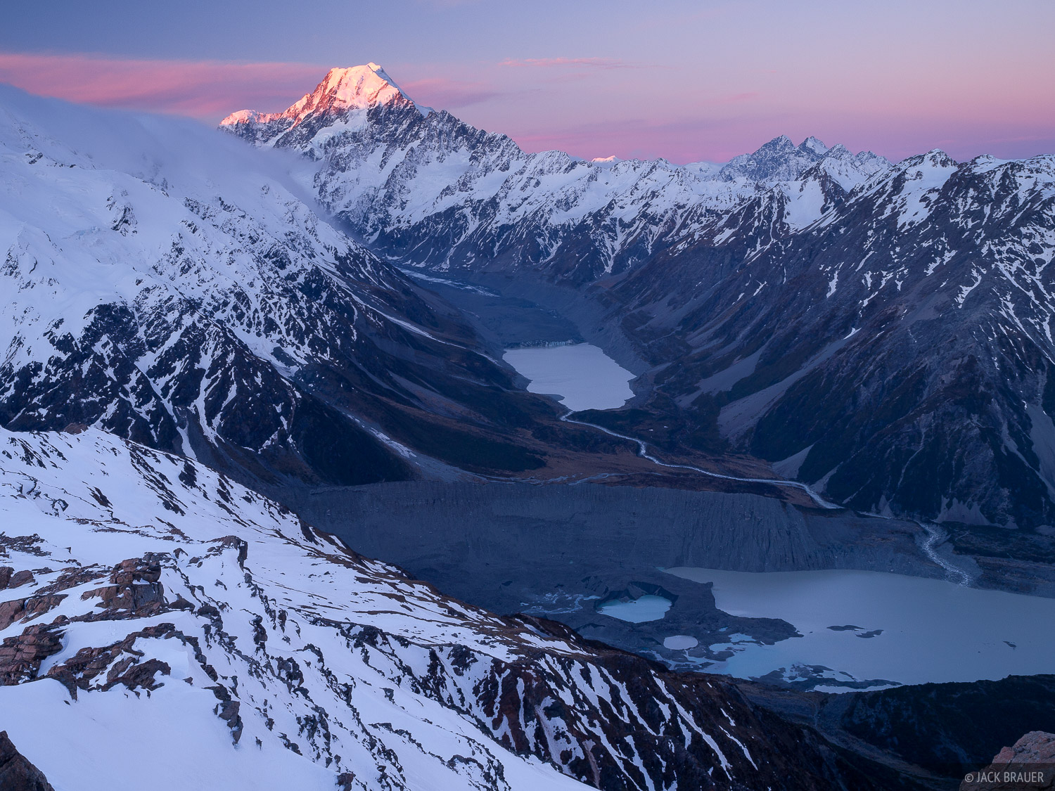 Sunset light on Aoraki/Mount Cook.  In the valley below is Mueller Lake (right), Hooker Lake, and the receding rock-covered Hooker...