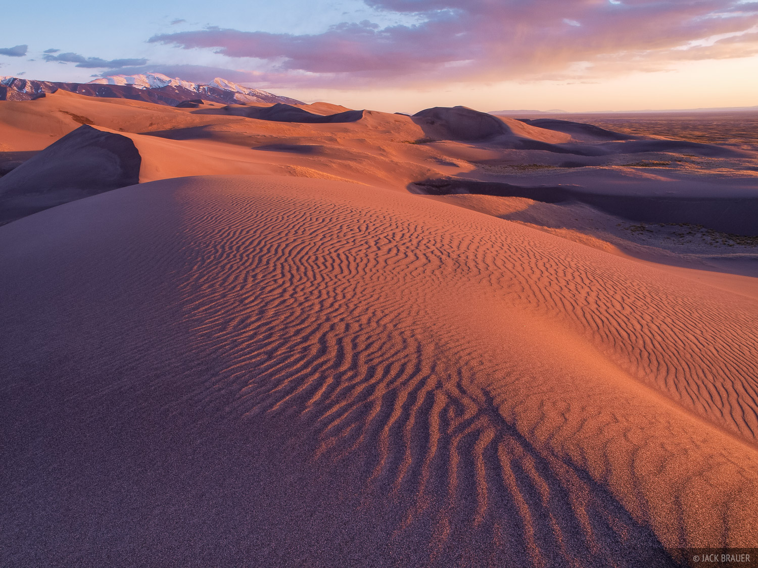 Sunset light illuminates the dunes along the remote western portion of the Great Sand Dunes National Park.