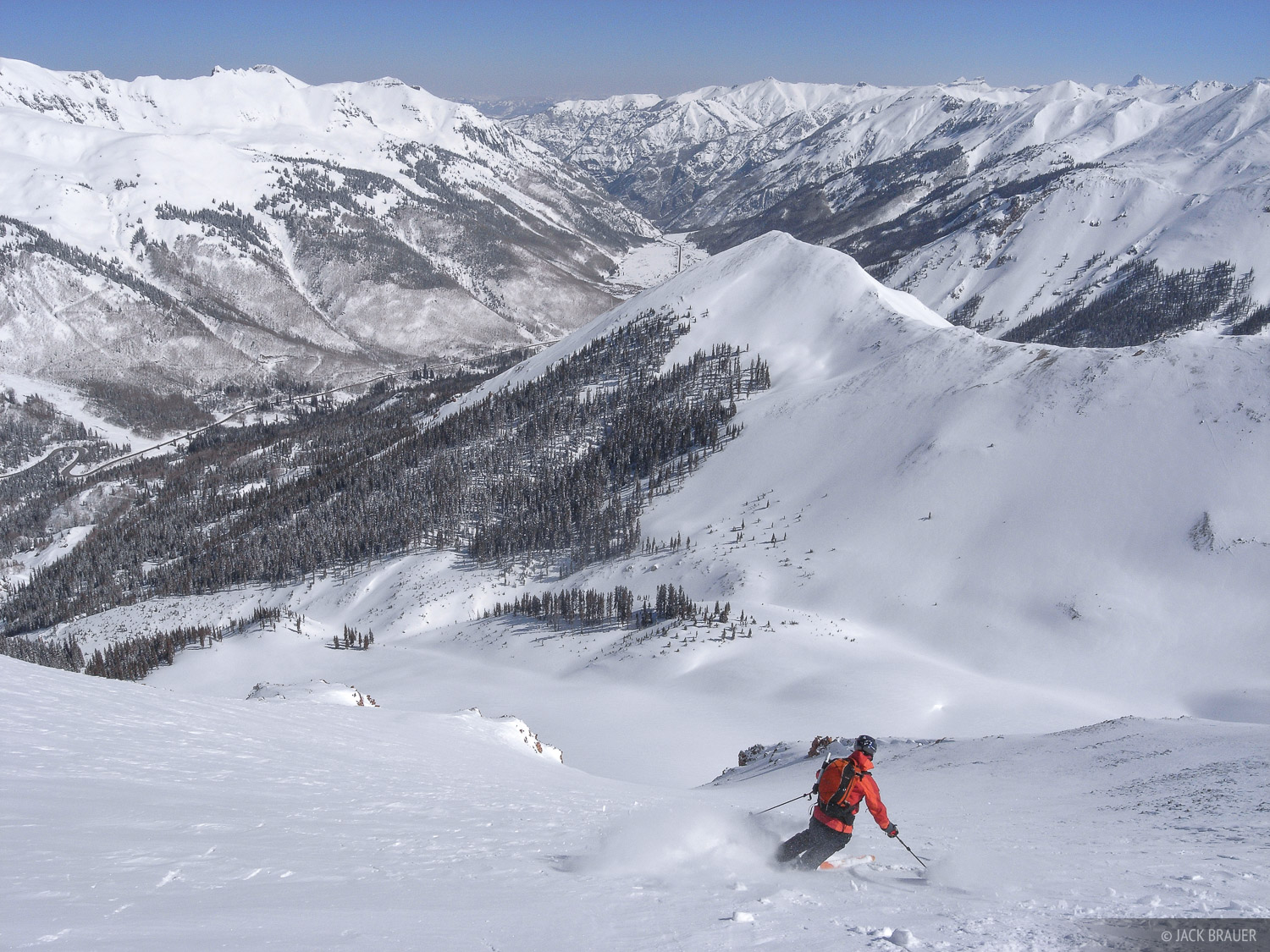 Skiing down the premier north face descent of a prominent 13er in the San Juans near Ouray - March. Skiier: Ann Driggers.