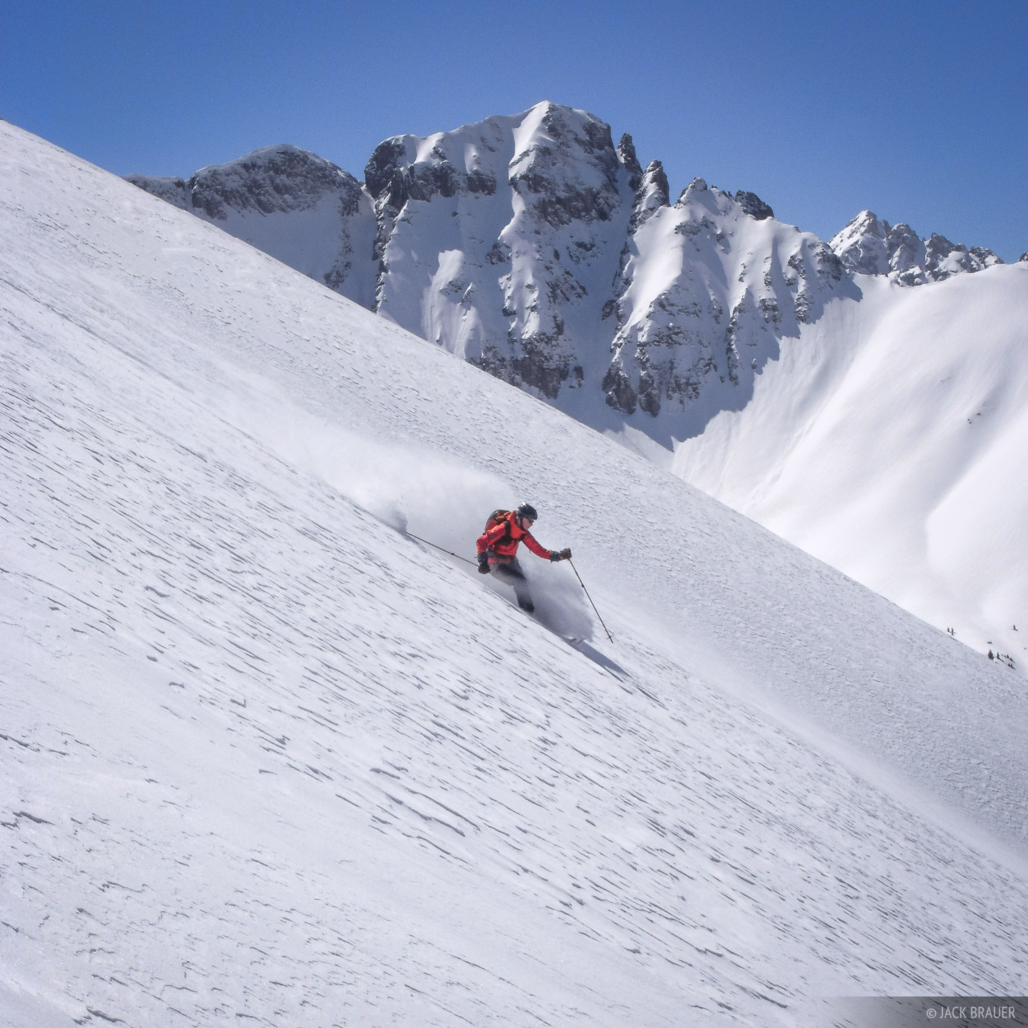 Backcountry skiing down a large steep face in the San Juans - March. Skiier: Ann Driggers.