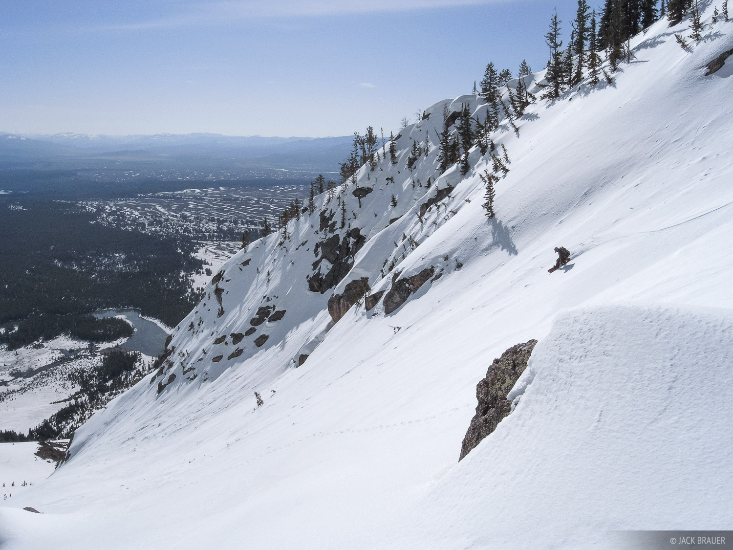 Snowboarding the middle slopes of the east face of Rockchuck Peak. Rider: Jason King.