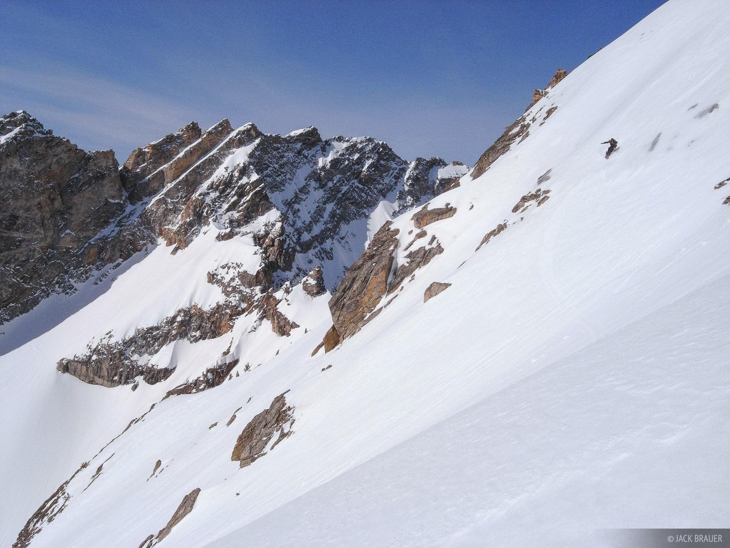 Jason King drops in to the steep east face of Rockchuck Peak.