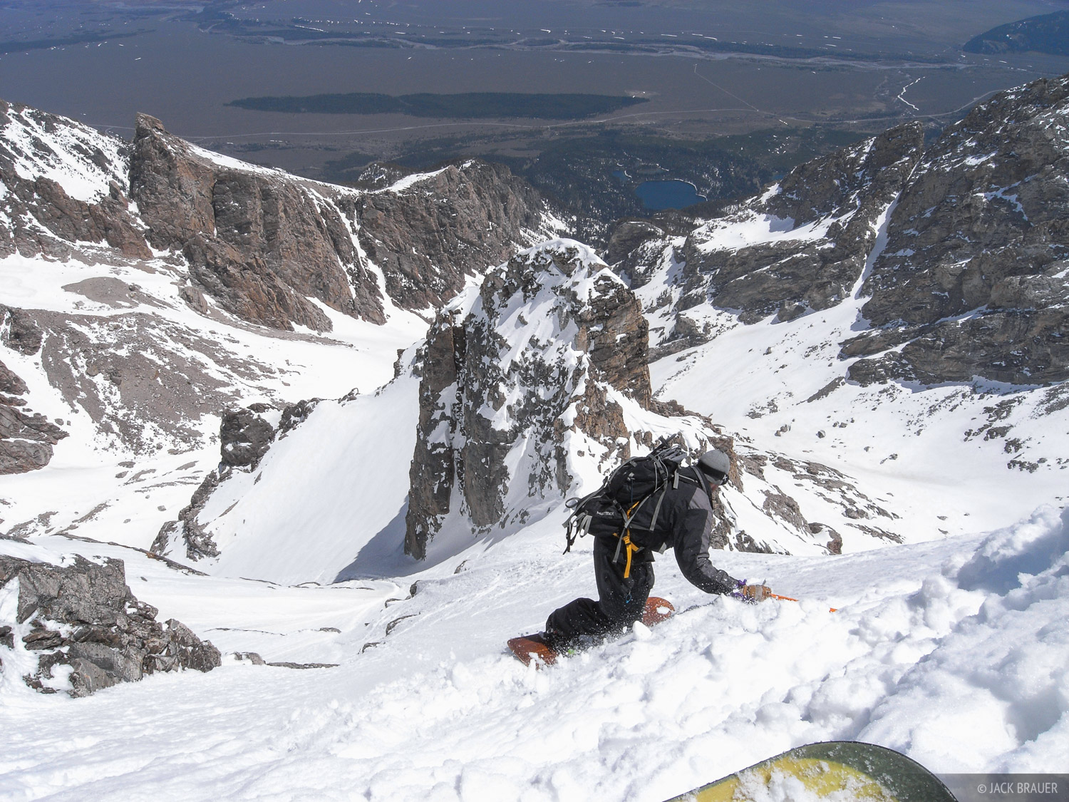 Jason King drops in to the steep northeast face of the Middle Teton. This is a lot steeper than it looks in the photo!