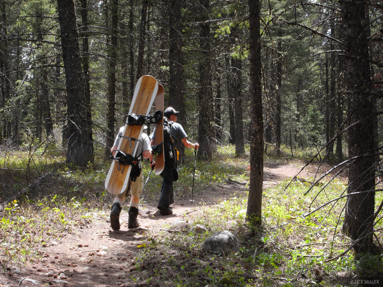 Hiking out the forest trail after a good day of riding.