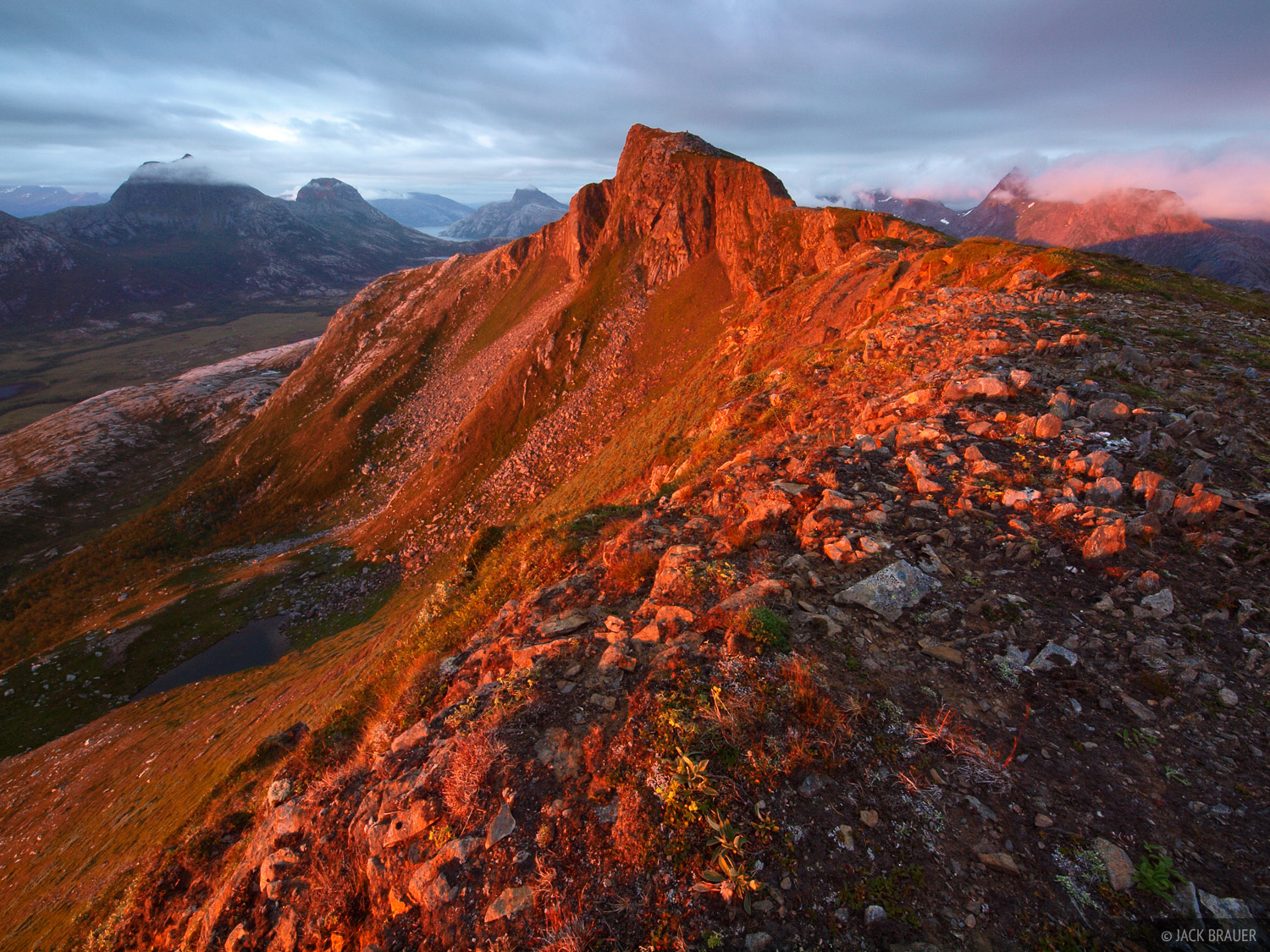 Blåfjellet peak illuminated by brilliant Arctic sunset light. This mountain is located near the tiny town of&nbsp...