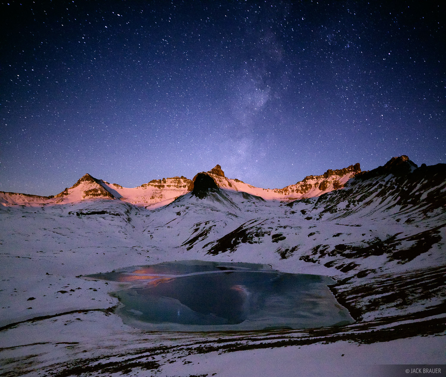 The rising moon casts lunar alpenglow on the peaks of Ice Lakes Basin in the San Juan Mountains of Colorado on this chilly November...