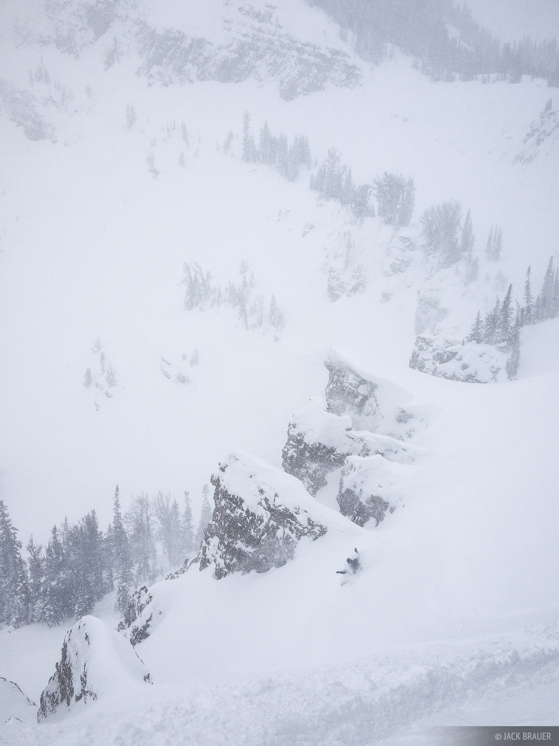 Jason King slashes down a chute through a rocky cliffband in the Jackson Hole slackcountry - February.