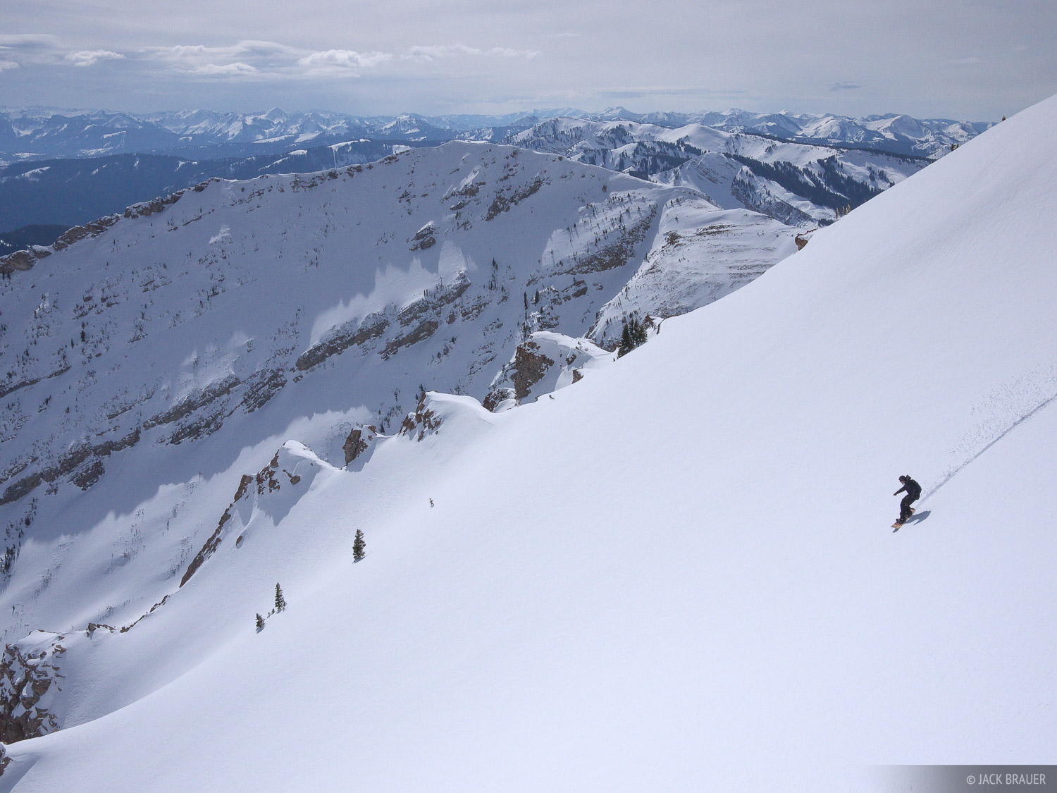 Jason King rides into a big bowl at the beginning of a 4,000 foot descent - March.