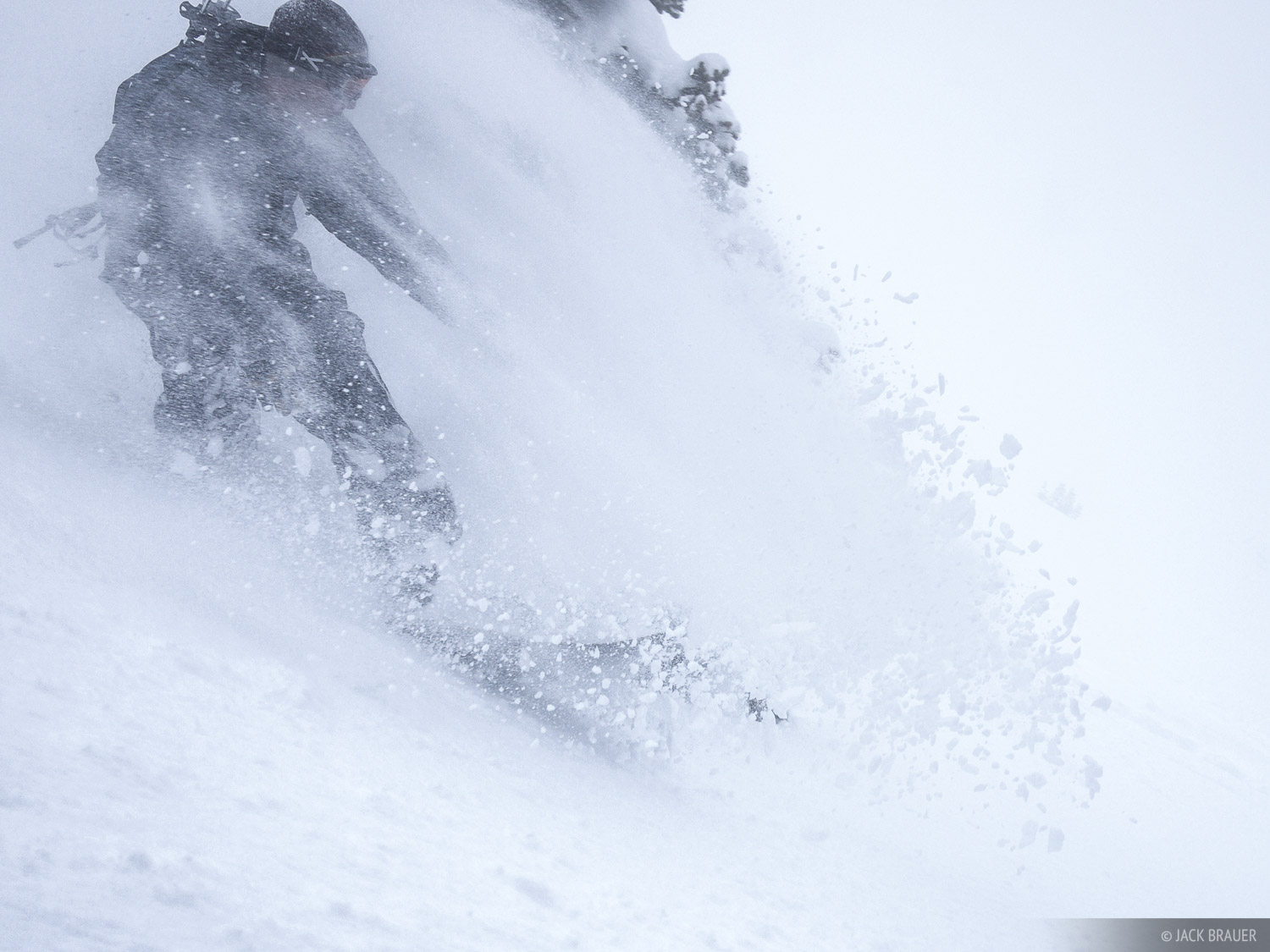 Jason King rides through his own powder cloud, Teton Pass, April.