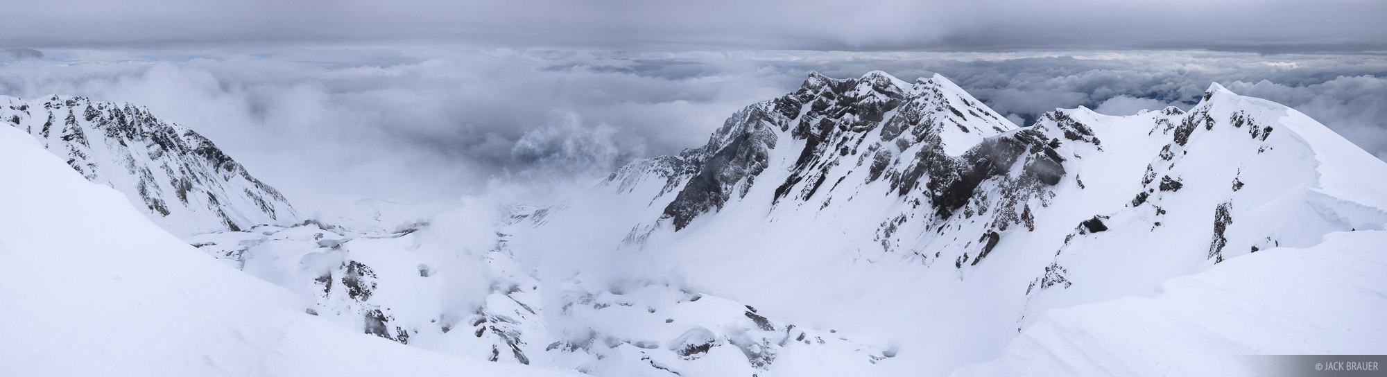 Panorama from the summit ridge, looking into the steaming crater of Mount Saint Helens which blew its top almost exactly 30 years...