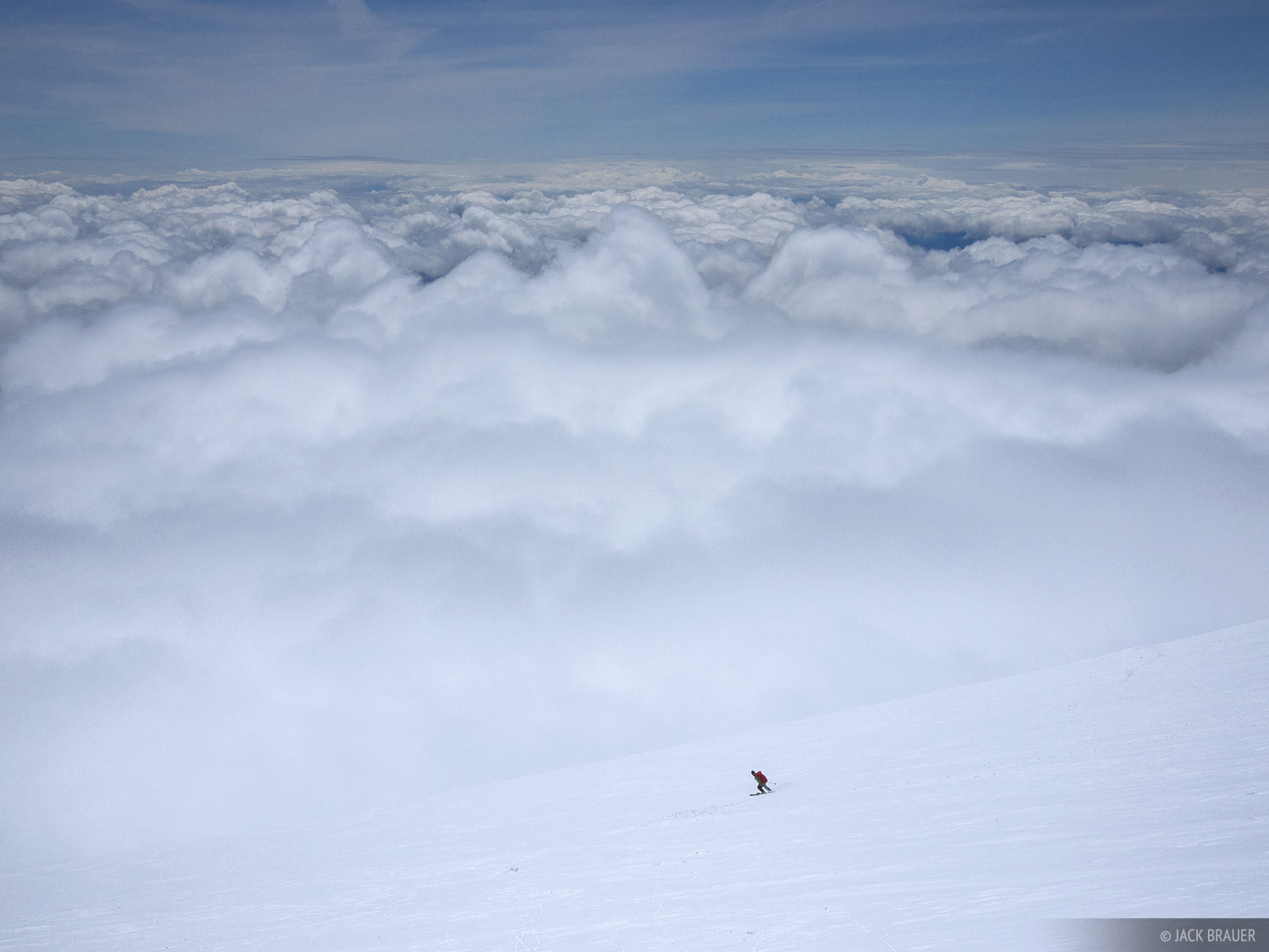 Skiing above the clouds on Mt. Adams, May. Skiier: Scott McCurdy.