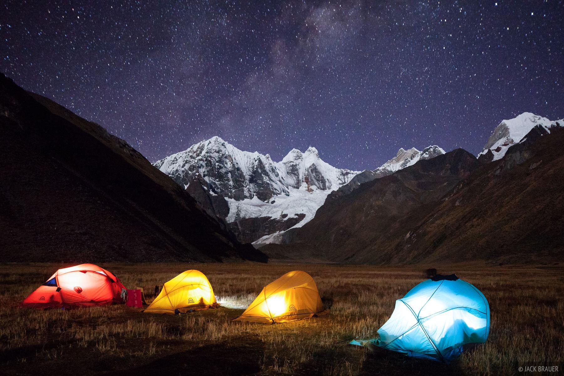 Colorful tents and nighttime stars at our camp below moonlit Jirishanca (6094m).