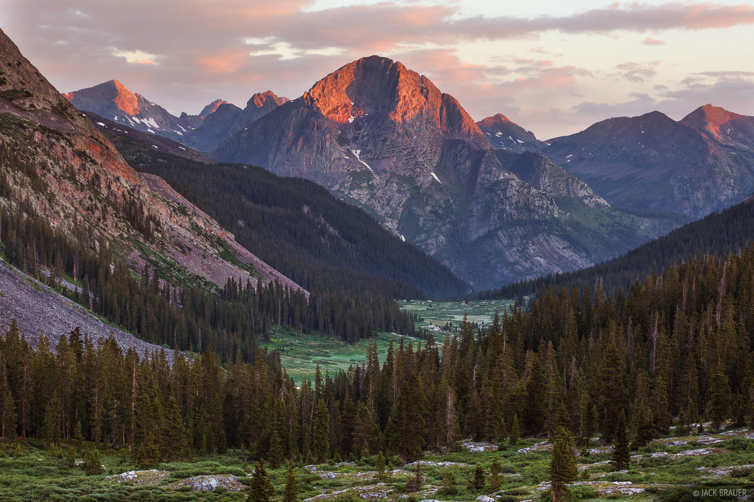 Sunrise alpenglow light on The Guardian (13,617 ft.), looking down Rock Creek, deep in the Weminuche Wilderness.