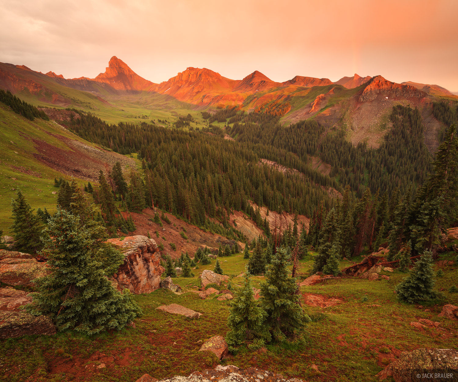 Wetterhorn Peak lights up with sunset alpenglow after a July monsoon thunderstorm.