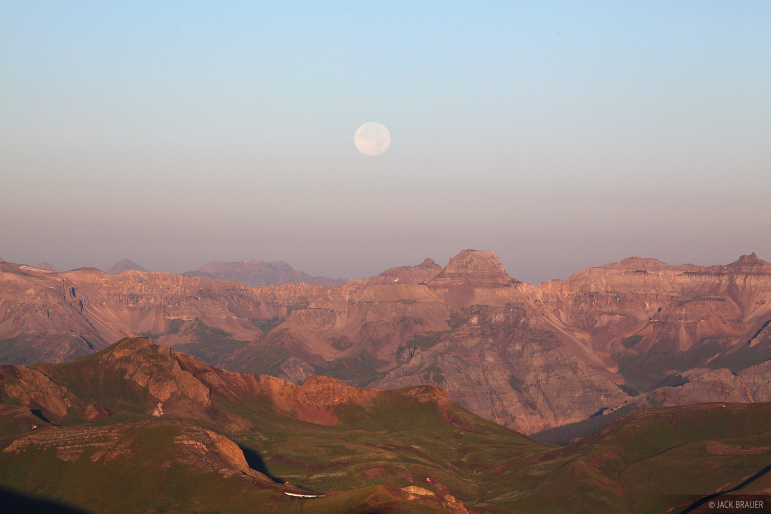 A nearly full moon sets over Potosi Peak and the Sneffels Range.