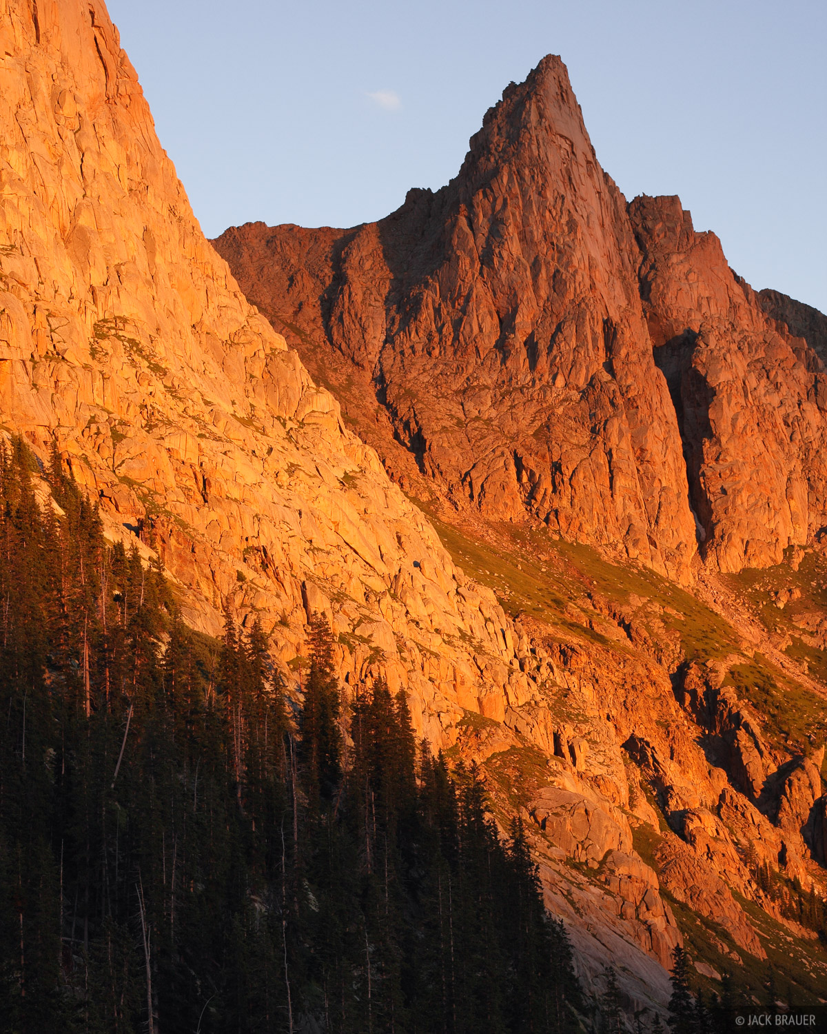 Sunset alpenglow on Knife Point, a rugged spire in the Needle Mountains.  In 2008 I hiked up to the top of this peak to...