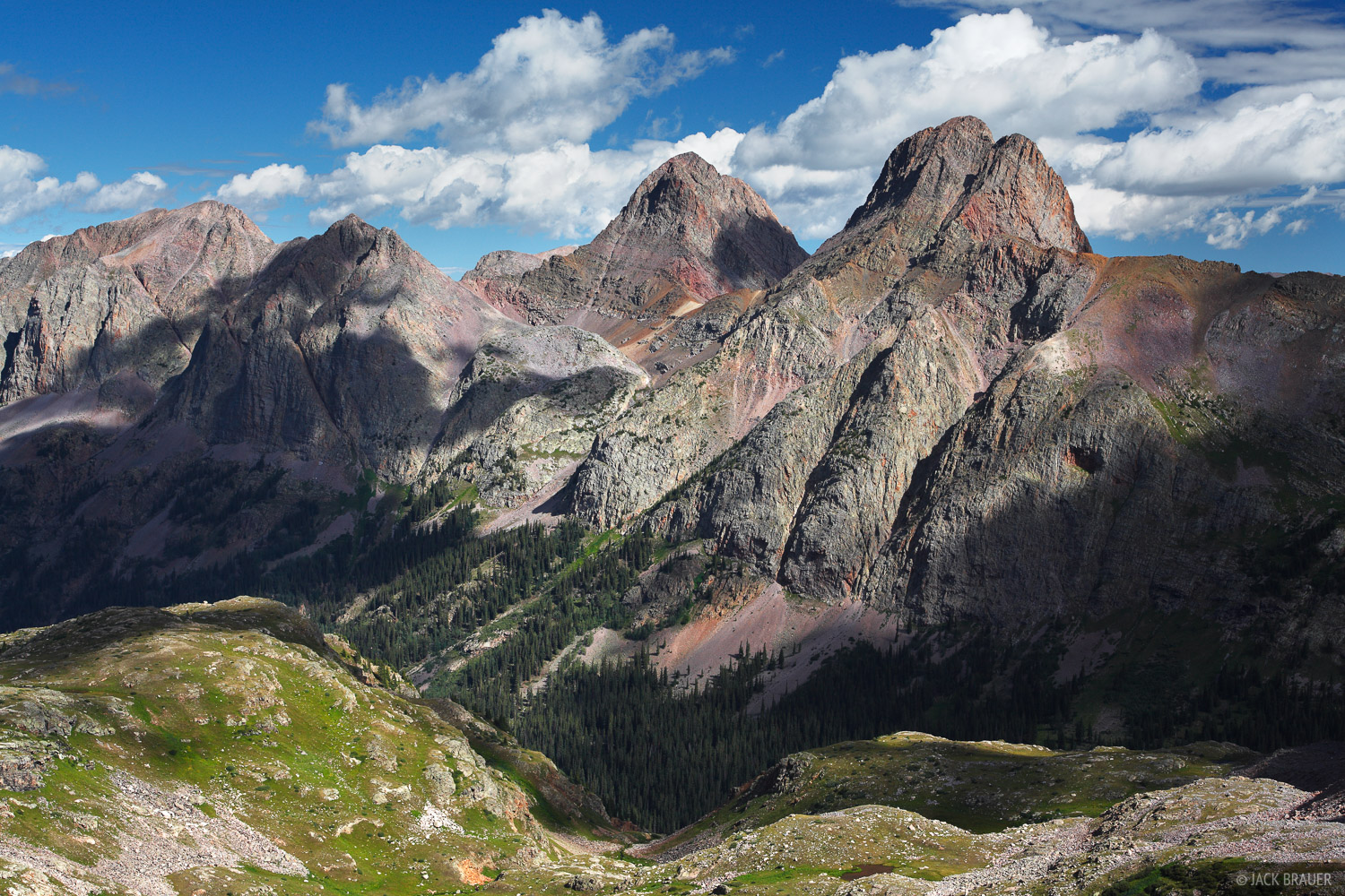 Clouds and shadows float by the Grenadier Range, in the heart of the San Juan Mountains of Colorado. The main peaks of...