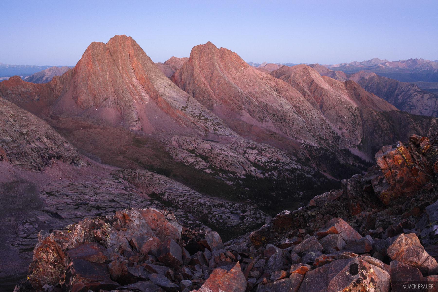 Dawn light on Vestal and Arrow Peaks in the Grenadier Range, Weminuche Wilderness - August.