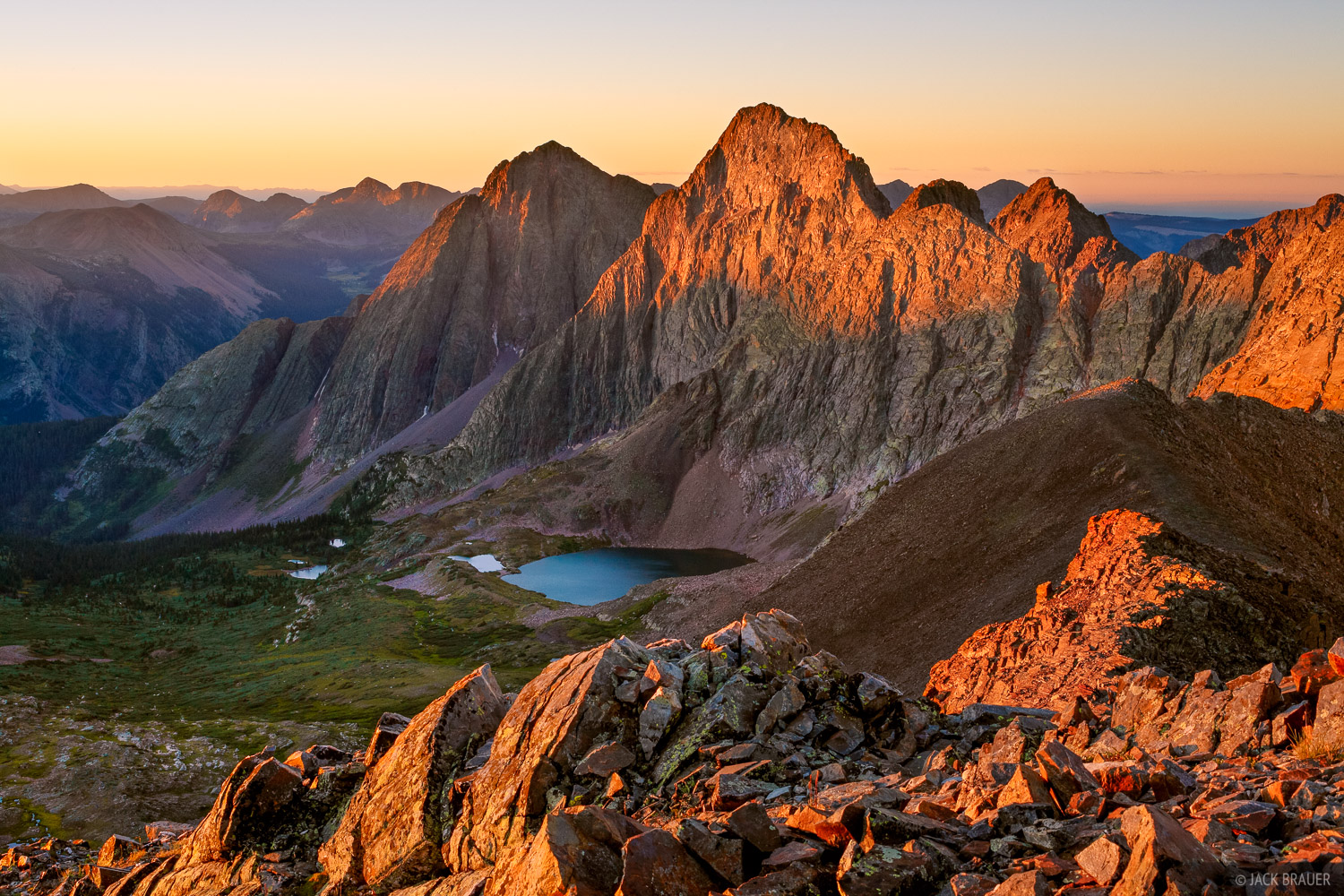 Sunrise alpenglow light on Storm King Peak (13,752 ft.), as seen from the summit of Peak Three, a seldom hiked peak offering...