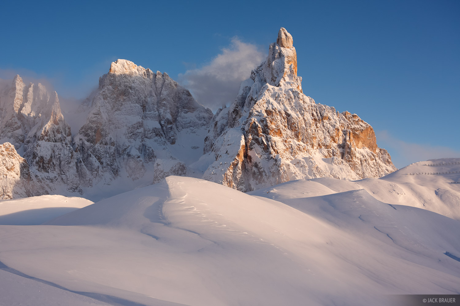 Late afternoon light on snowy Cimon della Pala, as storm clouds clear off - December.