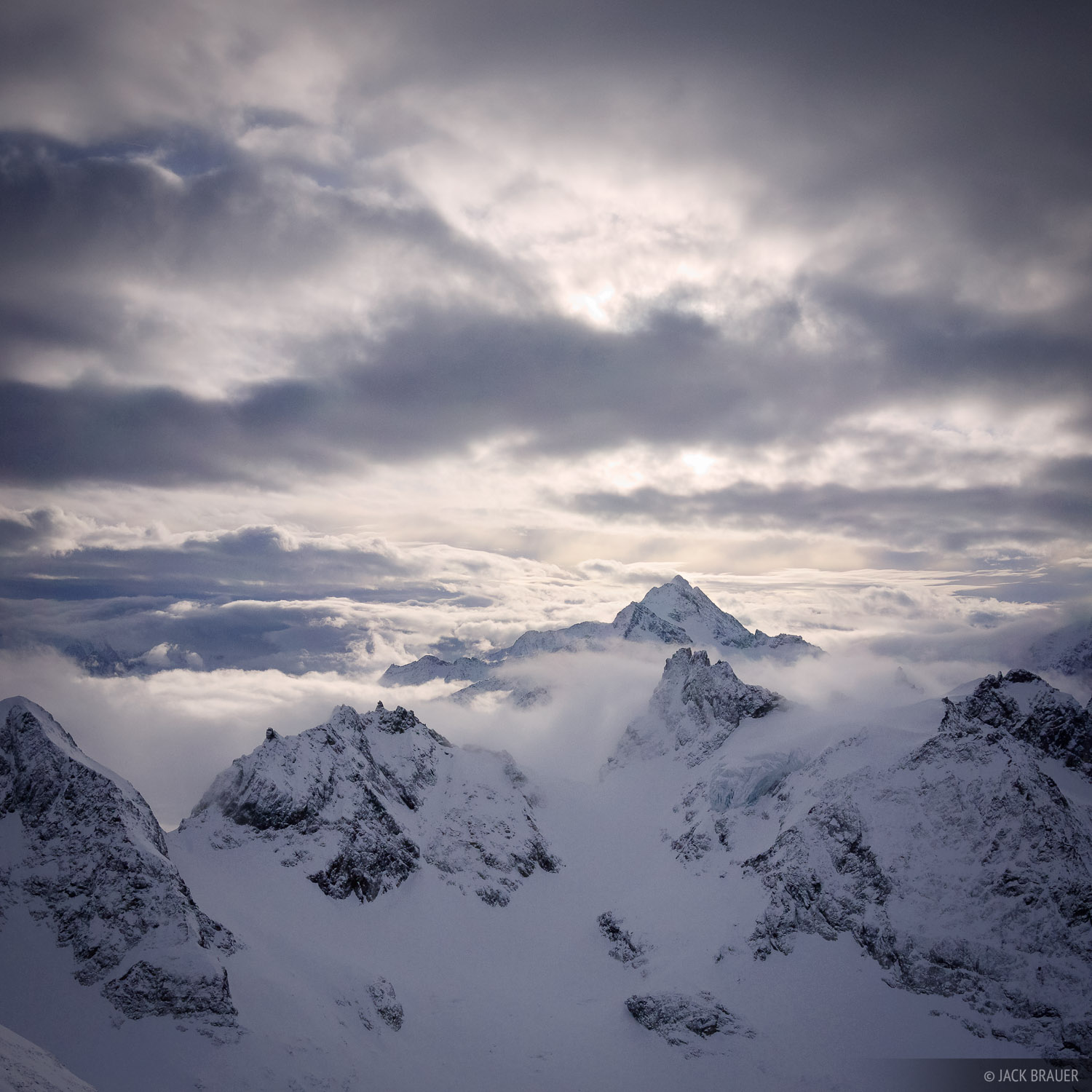 Misty clouds float amongst the peaks around Fleckistock, as seen from Klein Titlis - January.
