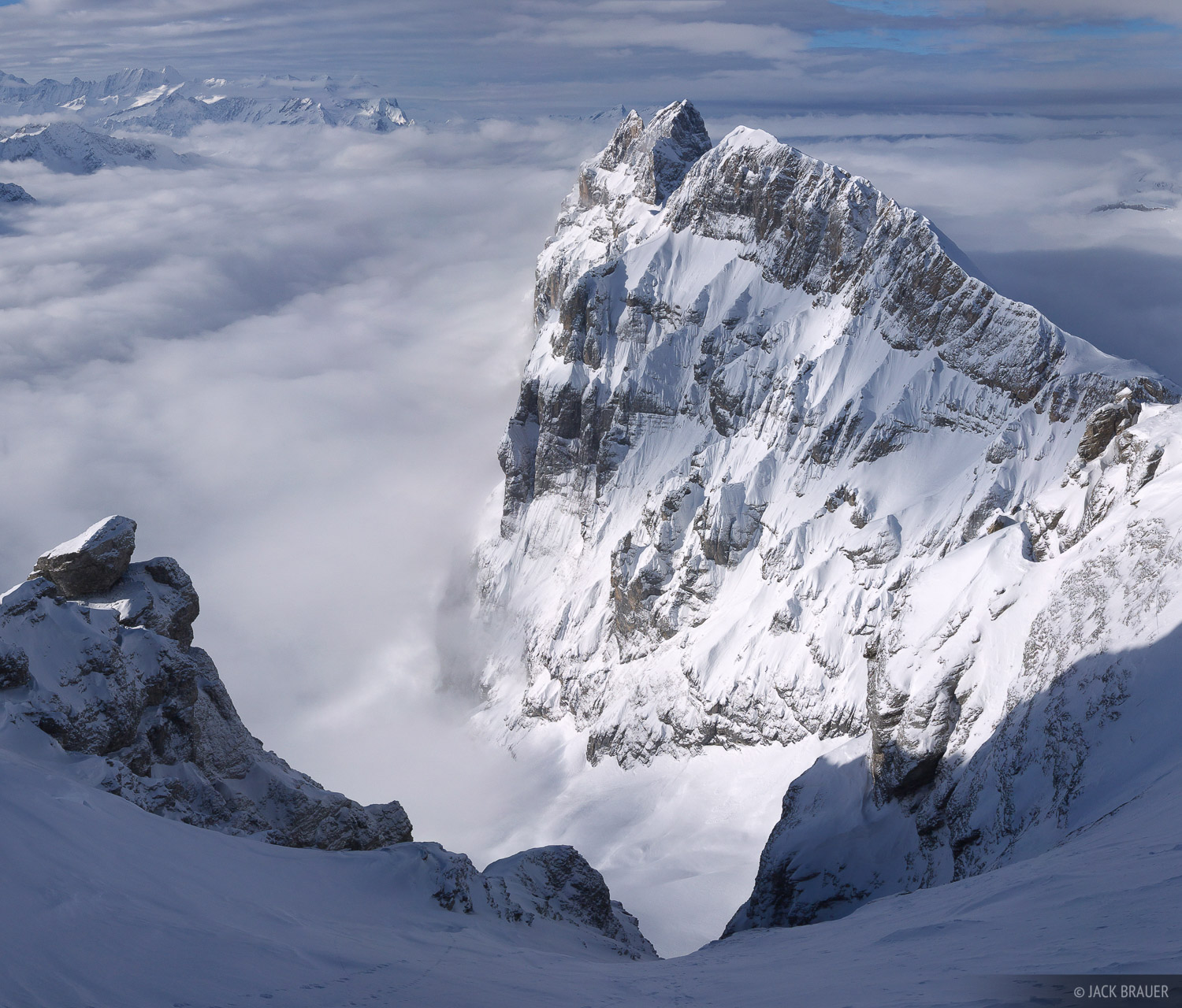 The sharp, steep ridge of Reissend Nollen (3,003m) towers above the clouds, as seen from Klein Titlis - January.