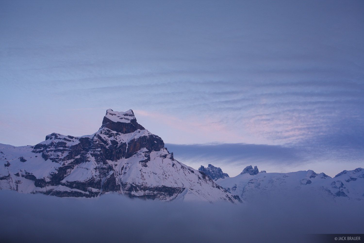 Hahnen rises over the clouds above the town of Engelberg, Switzerland.