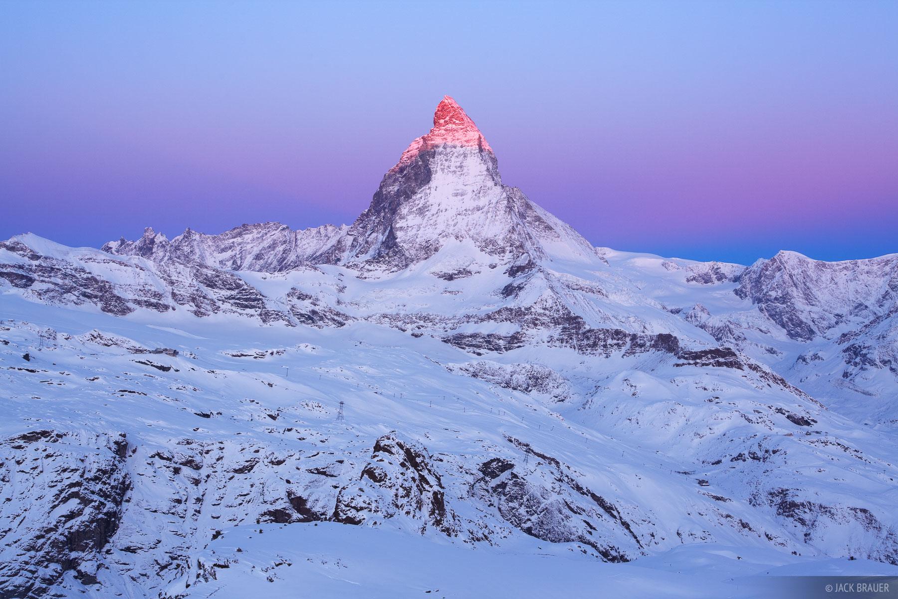 Sunrise alpenglow paints the summit of theMatterhorn (4478m / 14,692 ft.), as seen from Gornergrat.