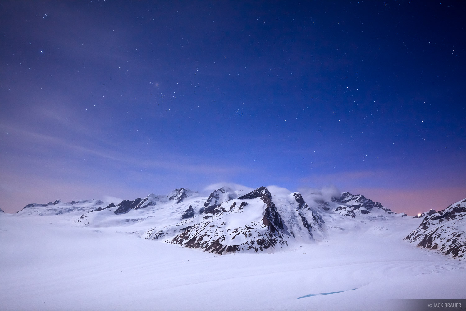 Moonlight and stars at Konkordiaplatz, the main junction of glaciers flowing into the Aletsch Glacier, the largest glacier in...