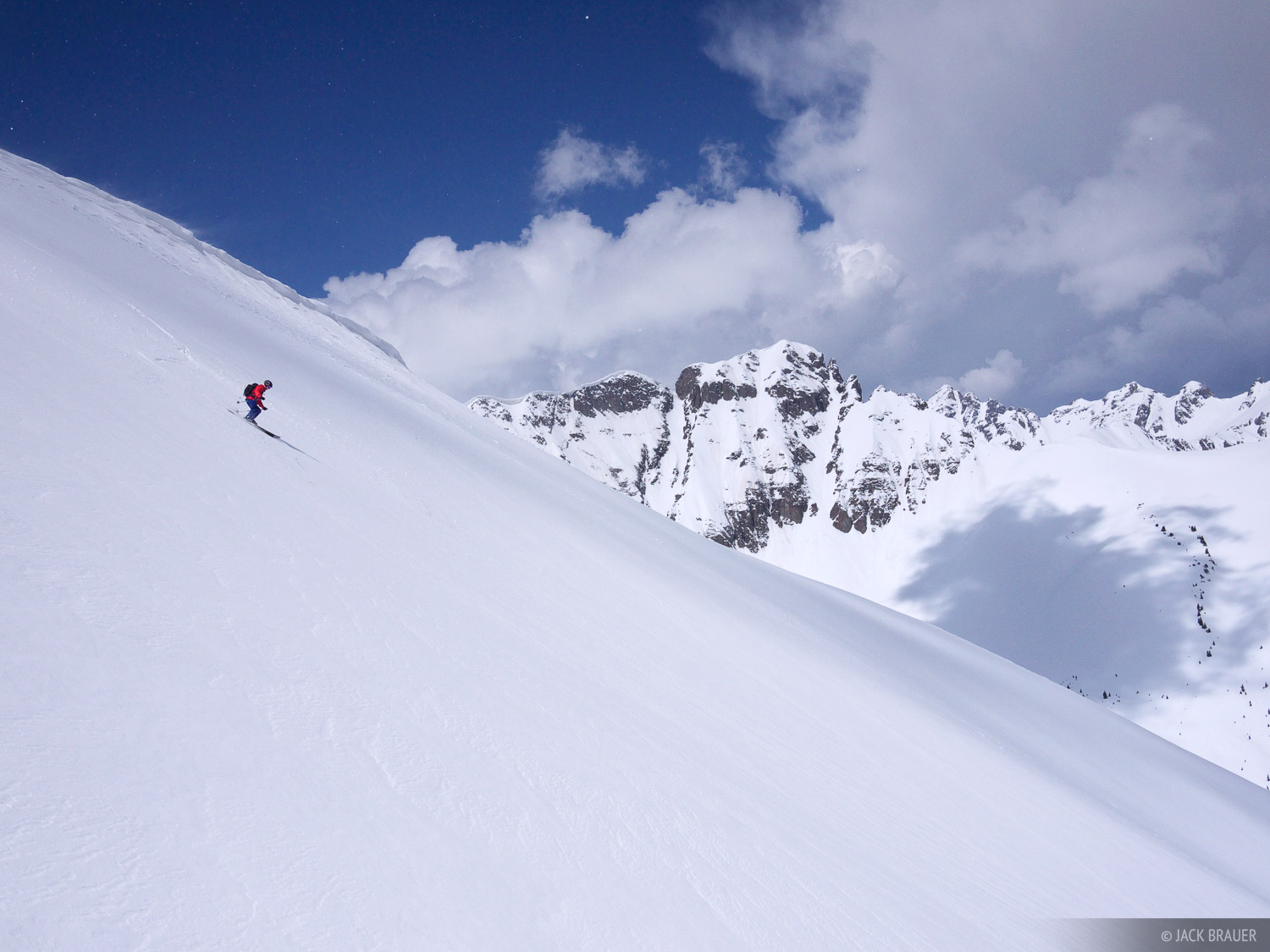 Skiing a large face, smooth as a pool table, in the San Juan Mountains, May.  Skier: Chris Cover.