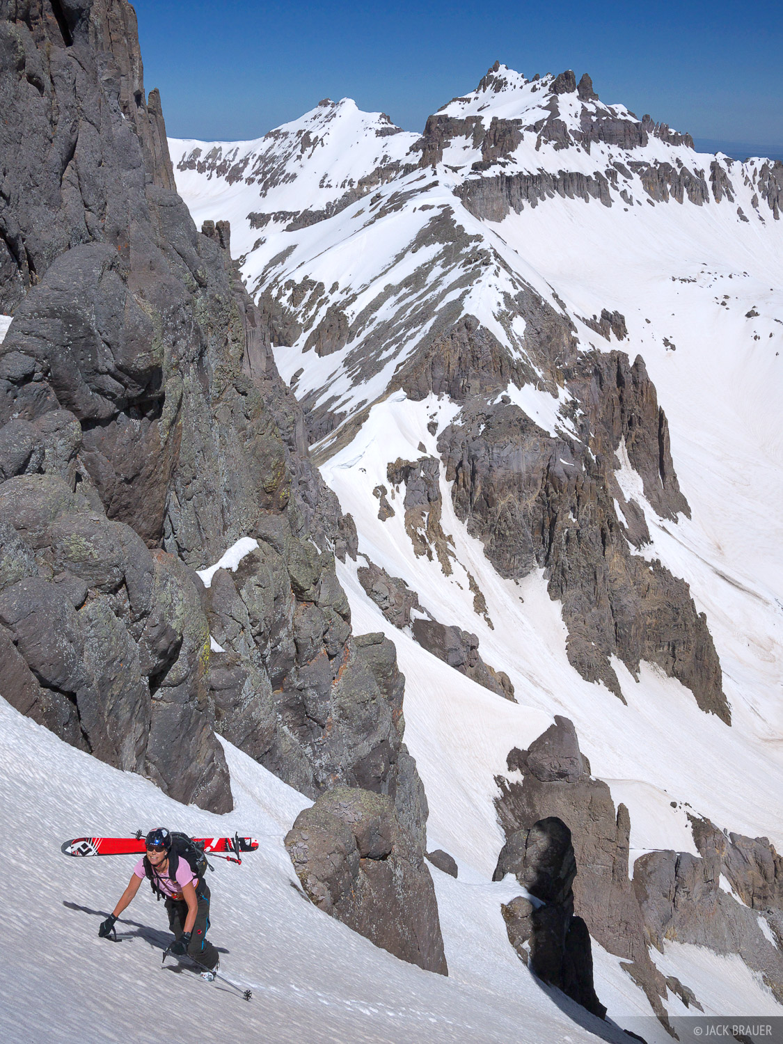 Ann Driggers climbs up the steep north couloir of Potosi Peak - June. Teakettle Mountain is in the background.  See more photos...