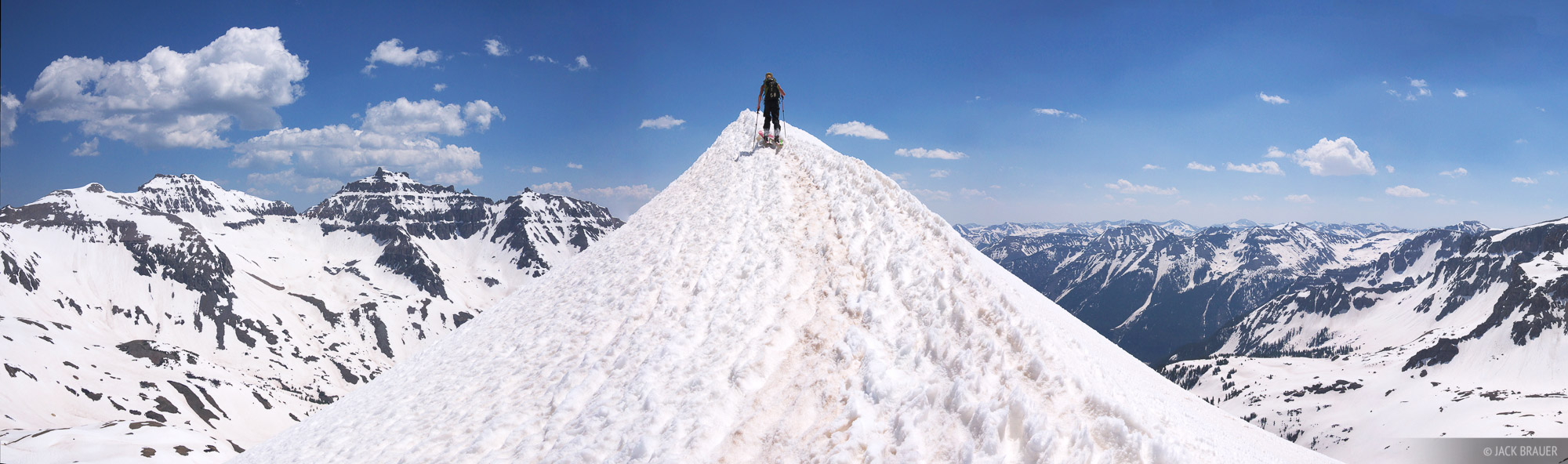 Aimee McAbery skins to the top of a snowy ridge in the San Juans - June.  View it larger here!